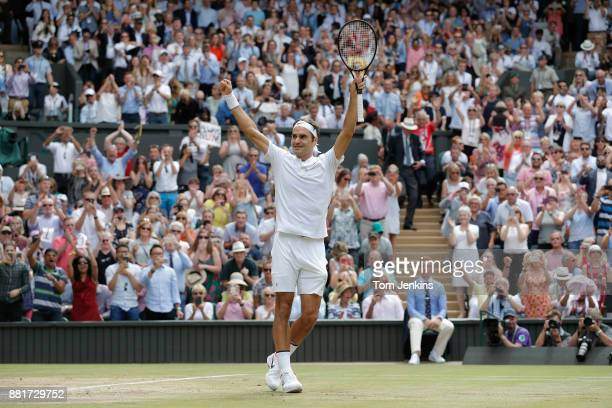 Roger Federer celebrates on matchpoint winning the men's singles final on Centre Court on day thirteen of the 2017 Wimbledon tennis championships at...