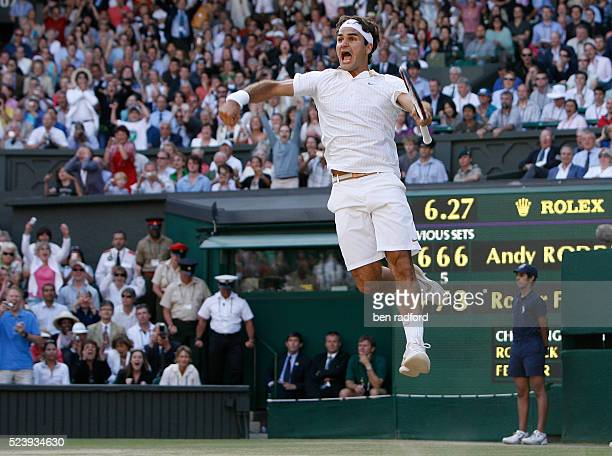 Roger Federer celebrates victory over Andy Roddick during the Men's Singles Final on Day 13 of the 2009 WImbledon Tennis Championship at the All...