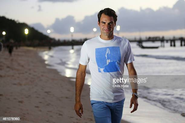 Roger Federer enjoys a relaxing walk along the beach on Tangalooma Island Resort on January 6 2015 in Brisbane Queensland Australia The tennis legend...