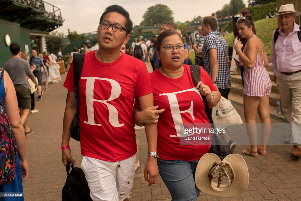 Roger Federer fans walk past Court 1 on day three of the Wimbledon Lawn Tennis Championships at the All England Lawn Tennis and Croquet Club on July 6, 2017 in London, England.