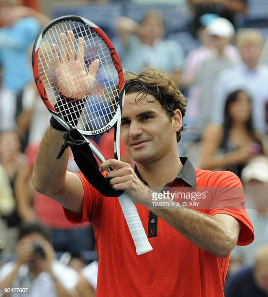 Roger Federer from Switzerland against Tommy Robredo from Spain during their 4th round US Open match at the USTA Billie Jean King National Tennis...