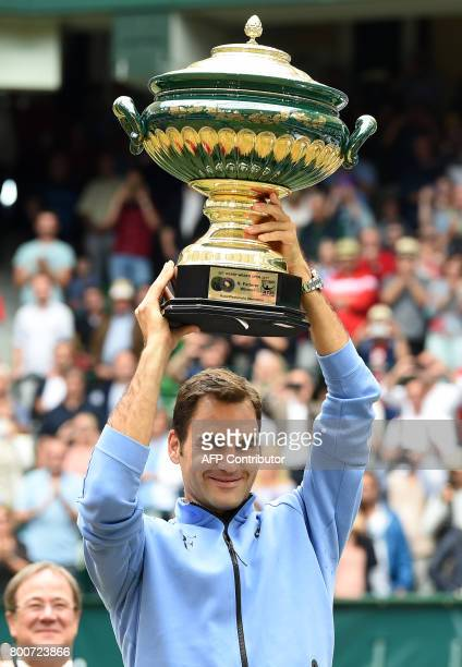 Roger Federer from Switzerland poses with his trophy after winning his final match against Alexander Zverev from Germany at the Gerry Weber Open...