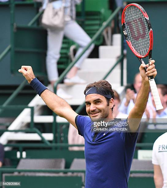 Roger Federer from Switzerland reacts after he won a guarterfinal against David Goffin from Belgium in the ATP tennis tournament in Halle western...