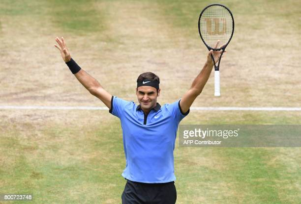 Roger Federer from Switzerland reacts after winning his final match against Alexander Zverev from Germany at the Gerry Weber Open tennis tournament...