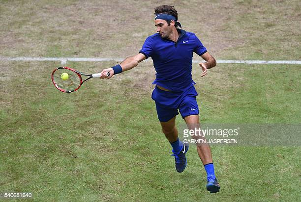 Roger Federer from Switzerland returns the ball during the Tennis match against Malek Jaziri from Tunisia in the ATP Tournament in Halle western...