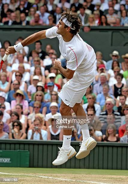 Roger Federer hits a serve to Sweden's Jonas Bjorkmen 62 60 62 in the Gentlemen's semifinal of the Wimbledon Championships Wimbledon England July 7...