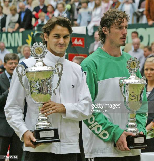 Roger Federer holds the championship trophy after winning the Gerry Weber Open title defeating Marat Safin in Halle Germany June 12 2005 Federer won...