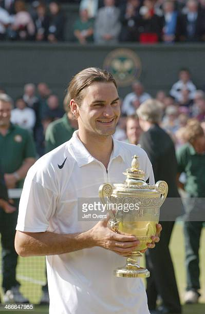 Roger Federer holds the trophy after winning the 2004 Wimbledon Championship Mens singles Final He beat Andy Roddick in the mens singles final 46 75...