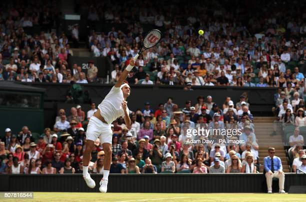 Roger Federer in action against Alexandr Dolgopolov on day two of the Wimbledon Championships at The All England Lawn Tennis and Croquet Club...