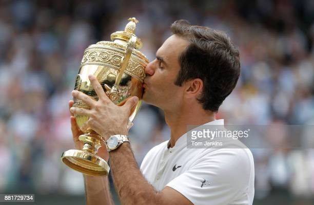 Roger Federer kisses the trophy after winning the men's singles final against Marin Cilic on Centre Court on day thirteen of the 2017 Wimbledon...