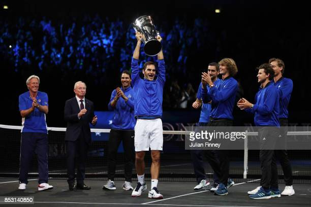 Roger Federer lifts the laver cup trophy with Marin Cilic Bjorn Borg Rafael Nadal Alexander Zverev Dominic Thiem Rod Laver and Tomas Berdych of Team...