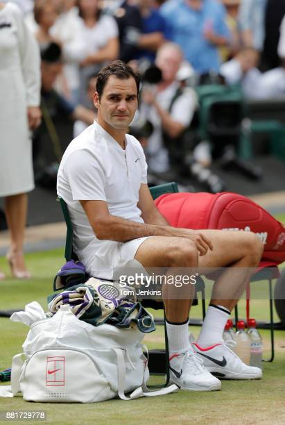 Roger Federer looks tearful as he sits in his chair awaiting the trophy presentation after his victory in the men's singles final v Marin Cilic on...