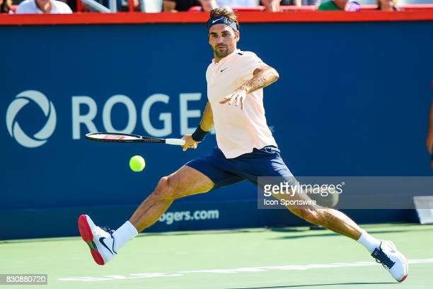 Roger Federer making eye contact with the ball and returns it during his semifinal match at ATP Coupe Rogers on August 12 at Uniprix Stadium in...