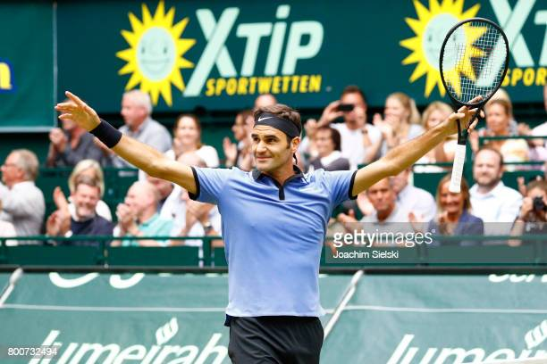 Roger Federer of Suiss cheers after the men's singles match against Alexander Zverev of Germany on Day 9 of the Gerry Weber Open 2017 at Gerry Weber...