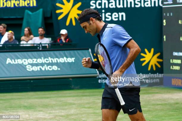 Roger Federer of Suiss cheers during the men's singles match against Alexander Zverev of Germany on Day 9 of the Gerry Weber Open 2017 at Gerry Weber...