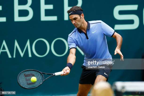 Roger Federer of Suiss returns the ball during the men's singles match against Alexander Zverev of Germany on Day 9 of the Gerry Weber Open 2017 at...