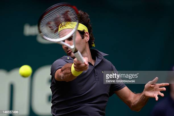 Roger Federer of Suisse plays a forehand in his round of 16 match against Florian Mayer of Germany during day four of the Gerry Weber Open at Gerry...