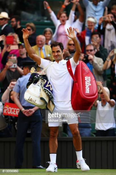 Roger Federer of Switzerland acknowledges the crowd as he celebrates victory after the Gentlemen's Singles quarter final match against Milos Raonic...