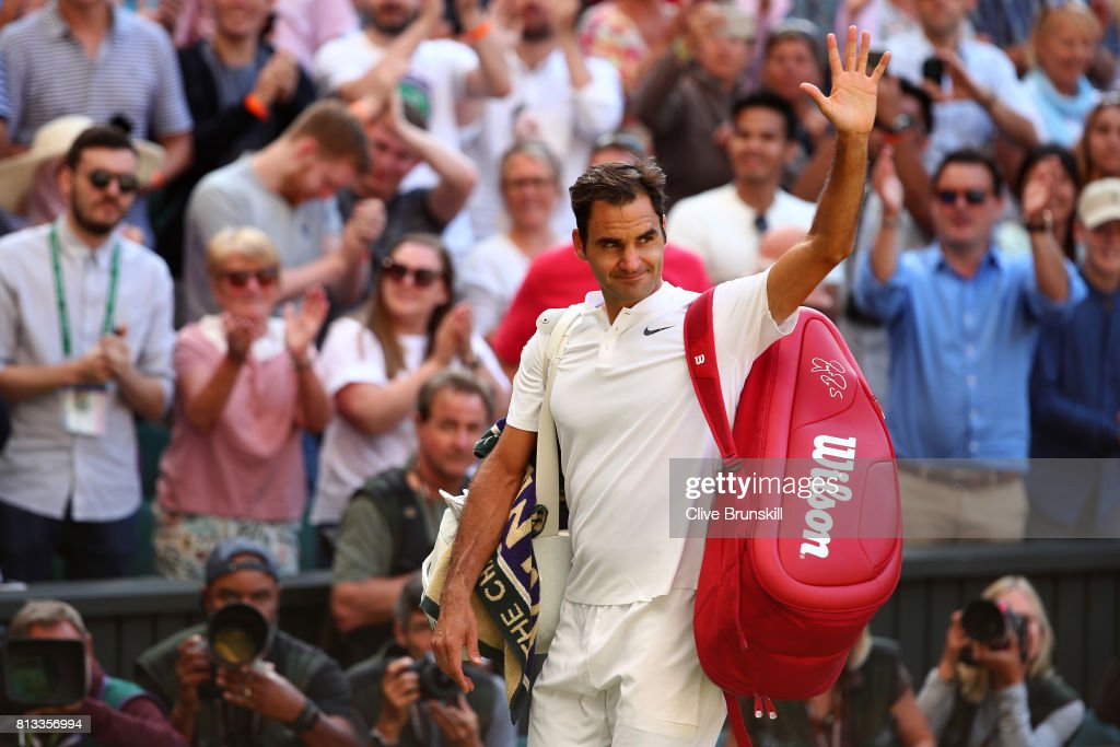 Roger Federer of Switzerland acknowledges the crowd as he celebrates victory after the Gentlemen's Singles quarter final match against Milos Raonic of Canada on day nine of the Wimbledon Lawn Tennis Championships at the All England Lawn Tennis and Croquet Club on July 12, 2017 in London, England.