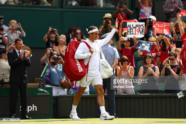Roger Federer of Switzerland acknowledges the crowd as he walks onto court prior to the during the Gentlemen's Singles first round match against...