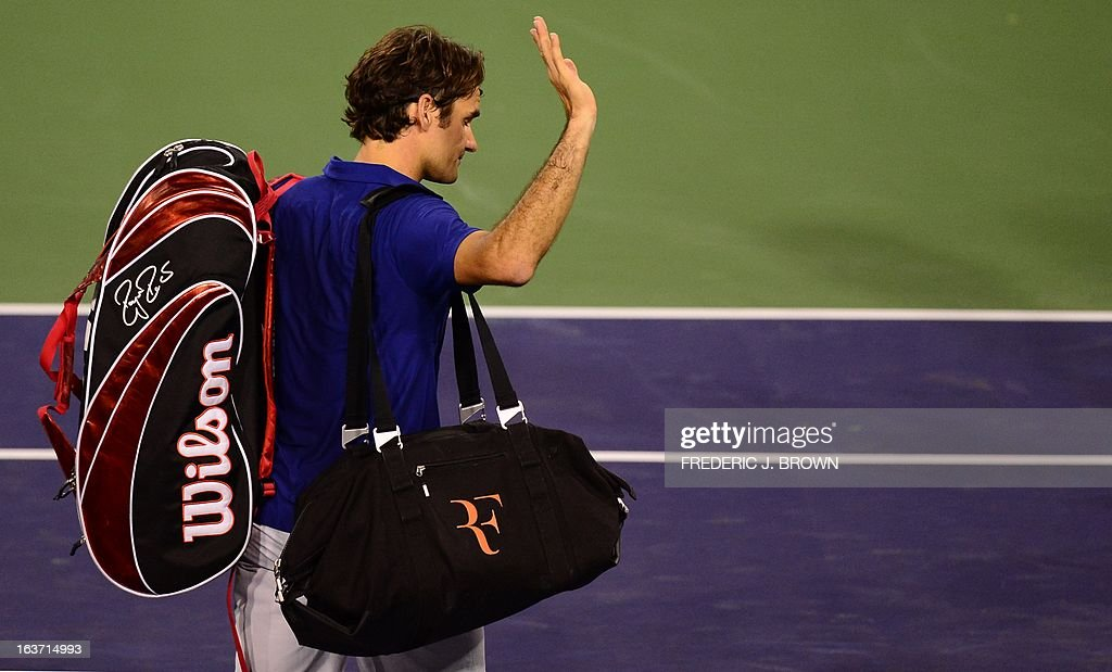 Roger Federer of Switzerland acknowledges the crowd following his defeat to Rafael Nadal of Spain on March 14, 2013 in Indian Wells, California, where Nadal defeated Federer in their quarterfinal match at the BNP Paribas Open. AFP PHOTO/Frederic J. BROWN