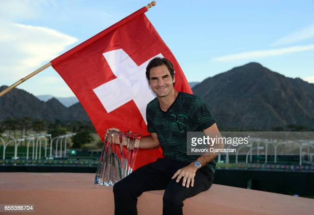 Roger Federer of Switzerland along with his BNP Paribas Open trophy poses for photographers after defeating Stan Wawrinka of Switzerland during the...