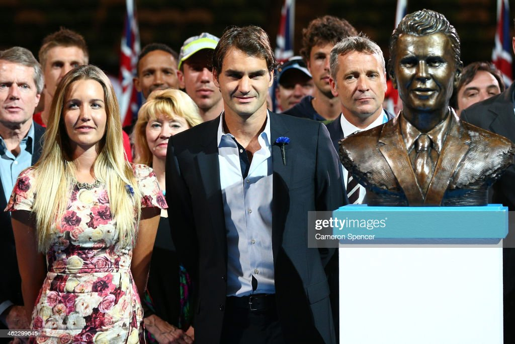 Roger Federer of Switzerland and Ally Drewett unveil a bust of her father Brad Drewett during day one of the 2014 Australian Open at Melbourne Park...