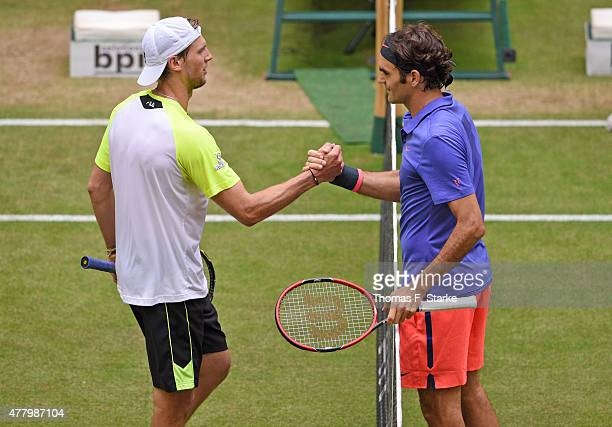 Roger Federer of Switzerland and Andreas Seppi of Italy shake hands after final match during the final day of the Gerry Weber Open at Gerry Weber...