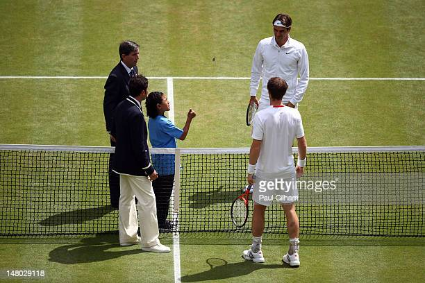 Roger Federer of Switzerland and Andy Murray of Great Britain during the coin toss prior to their Gentlemen's Singles final match on day thirteen of...