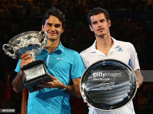 Roger Federer of Switzerland and Andy Murray of Great Britain pose with their trophies after the men's final match during day fourteen of the 2010...
