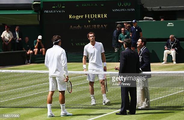Roger Federer of Switzerland and Andy Murray of Great Britain toss the coin prior to their Gentlemen's Singles final match on day thirteen of the...