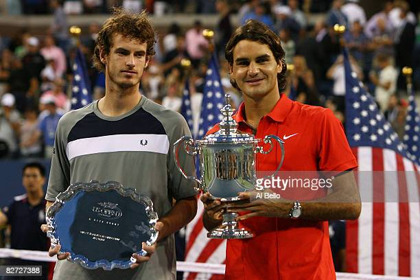 Roger Federer of Switzerland and Andy Murray of the United Kingdom pose with their trophies after the 2008 US Open Men's Championship Match in Arthur...