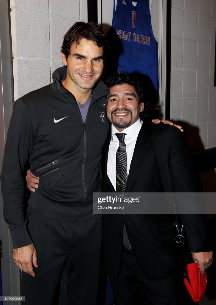 Roger Federer of Switzerland (L) and Former Argentinian footballer Diego Maradona attend the ATP World Tour Finals at O2 Arena on November 23, 2010 in London, England.