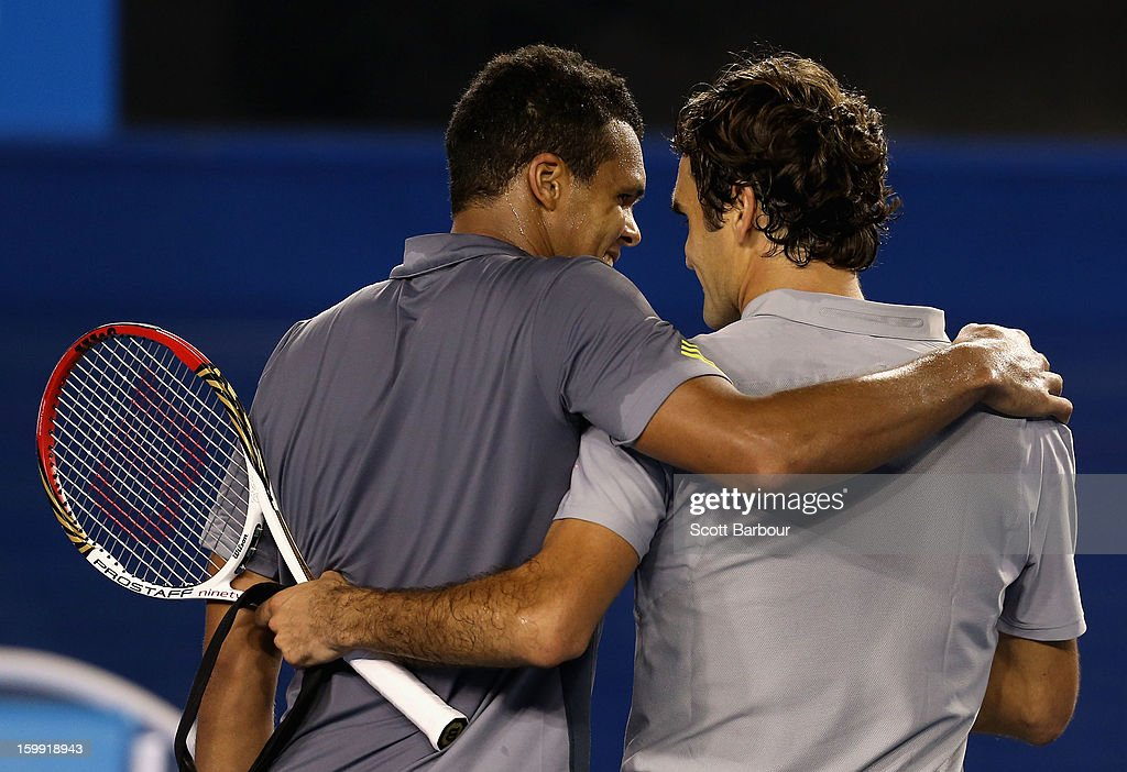 Roger Federer of Switzerland and Jo-Wilfred Tsonga of France chat after Federer won their Quarterfinal match during day ten of the 2013 Australian Open at Melbourne Park on January 23, 2013 in Melbourne, Australia.