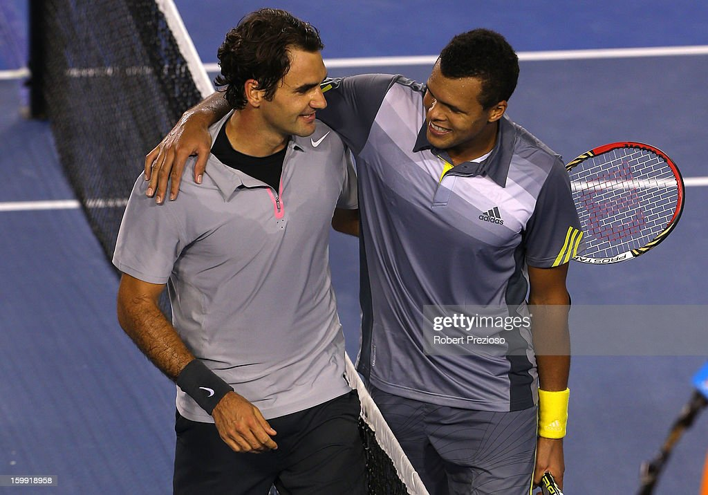 Roger Federer of Switzerland and Jo-Wilfred Tsonga of France shake hands after Federer won their Quarterfinal match during day ten of the 2013 Australian Open at Melbourne Park on January 23, 2013 in Melbourne, Australia.
