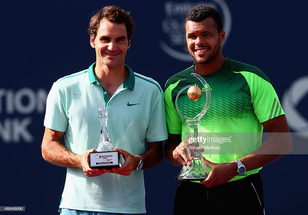Roger Federer of Switzerland and Jo-Wilfried Tsonga of France pose for photos after their finals match during Rogers Cup at Rexall Centre at York University on August 10, 2014 in Toronto, Canada.
