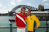Roger Federer of Switzerland and Lleyton Hewitt of Australia pose during the official draw for the Davis Cup World Group Playoff Tie between...