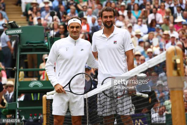 Roger Federer of Switzerland and Marin Cilic of Croatia pose prior to Gentlemen's Singles final on day thirteen of the Wimbledon Lawn Tennis...