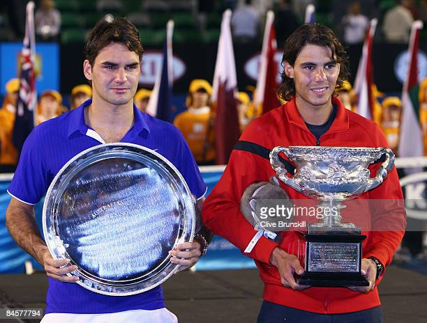 Roger Federer of Switzerland and Rafael Nadal of Spain pose with their trophies after the men's final match during day fourteen of the 2009...
