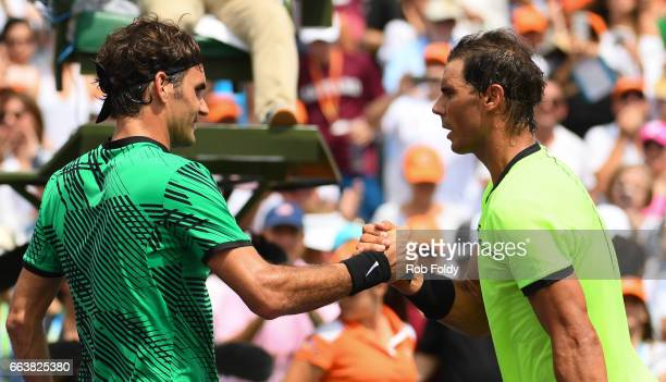 Roger Federer of Switzerland and Rafael Nadal of Spain shake hands after Federer defeated Nadal in the men's final match on day 14 of the Miami Open...