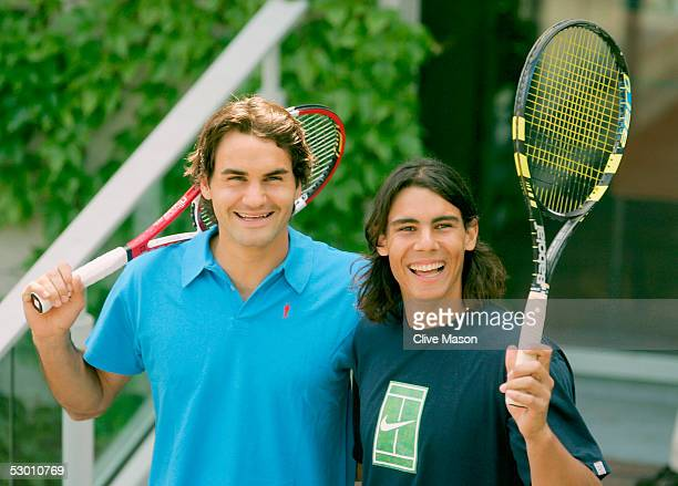 Roger Federer of Switzerland and Rafael Nadal of Spain stand side by side as they pose for photos prior to their semifinal match tomorrow during the...