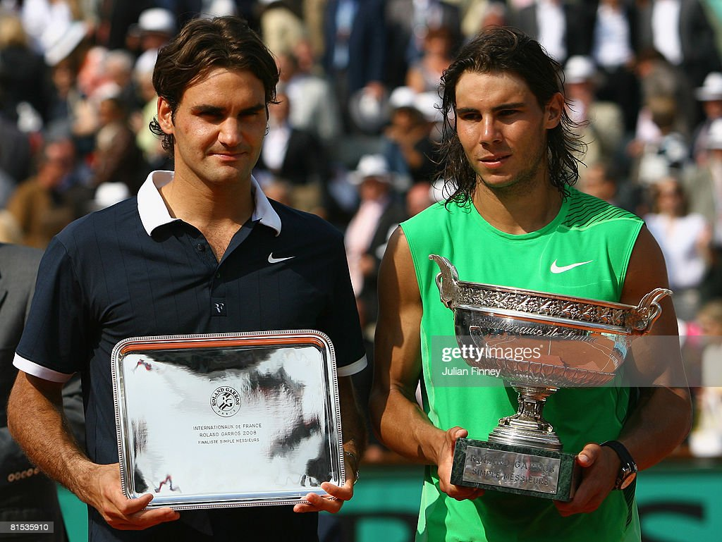 Roger Federer of Switzerland and Rafael Nadal of Spain with their trophies after the Men's Singles Final match on day fifteen of the French Open at...
