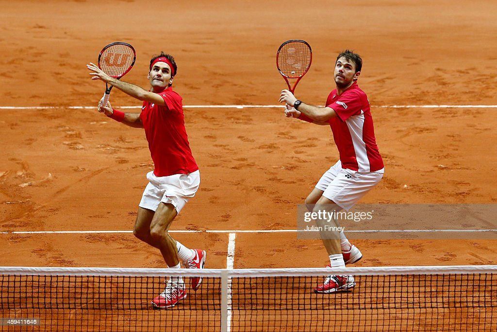 Roger Federer of Switzerland and Stanislas Wawrinka of Switzerland in action against Richard Gasquet of France and Julien Benneteau of France in the doubles during day two of the Davis Cup Tennis Final between France and Switzerland at the Stade Pierre Mauroy on November 22, 2014 in Lille, France.