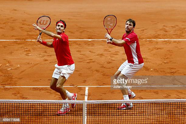 Roger Federer of Switzerland and Stanislas Wawrinka of Switzerland in action against Richard Gasquet of France and Julien Benneteau of France in the...