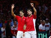 Roger Federer of Switzerland and Stanislas Wawrinka of Switzerland celebrate defeating Richard Gasquet of France and Julien Benneteau of France in...