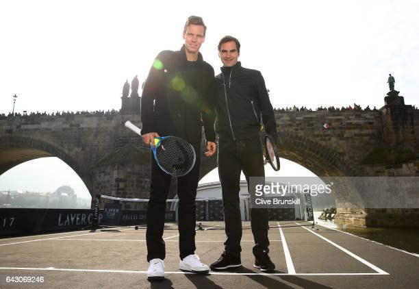 Roger Federer of Switzerland and Tomas Berdych of The Czech Republic pose for photos in front of the Charles Bridge during the countdown to the...