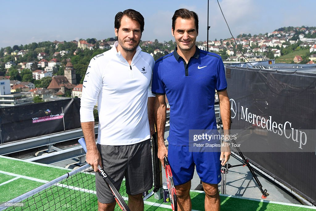 Roger Federer (R) of Switzerland and Tommy Haas of Germany at a PR Promotion for the Mercedes Cup on the roof top of the still in construction Cloud 7 development on June 6, 2016 in Stuttgart, Germany.