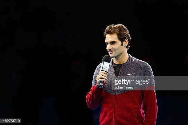 Roger Federer of Switzerland announces his decision to withdrwa from the singles final match against Novak Djokovic of Serbia on day eight of the...