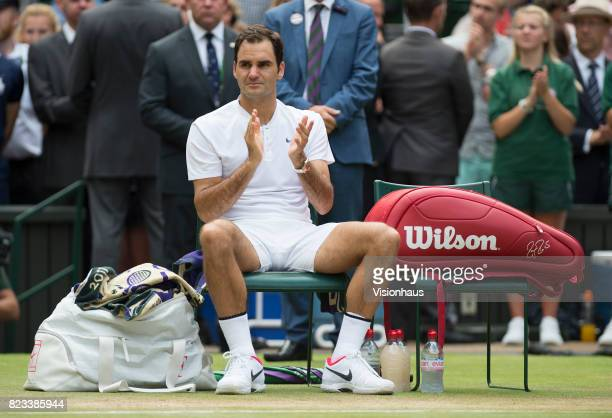 Roger Federer of Switzerland applauds defeated Marin Cilic after winning the Men's Singles Final against Marin Cilic on day thirteen of the Wimbledon...