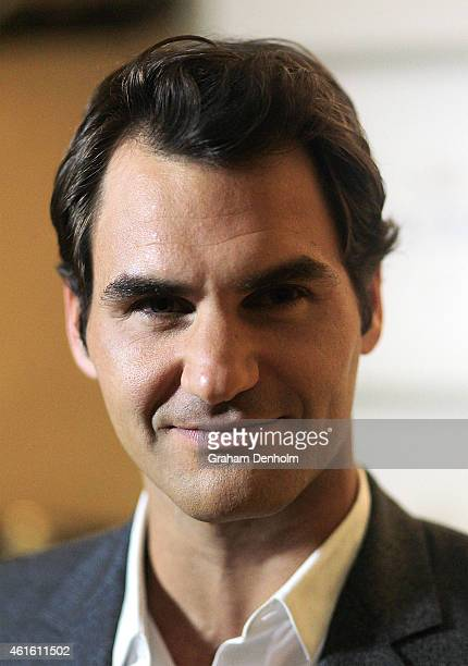 Roger Federer of Switzerland arrives at the Moet Chandon event ahead of the Australian Open Tournament at the Crown Towers on January 16 2015 in...